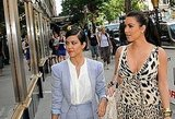 Kim and Kourtney Kardashian were spotted window shopping in NYC.