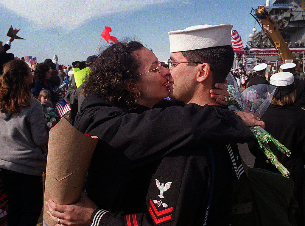 Nicole Rodriguez kisses her husband, Richard, a sailor based on the the aircraft carrier USS Enterprise, as he returns from deployment on Nov. 10, 2001.