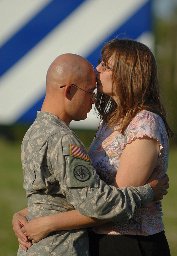Sgt. Joshua Hanafin gets a kiss from wife, Elizabeth, on May 4, 2008 in Fort Stewart, GA.
