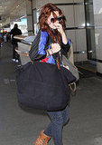 Drew Barrymore carried her luggage arriving at LAX.