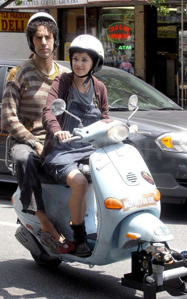 Anna Faris gave Sacha Baron Cohen a scooter ride.