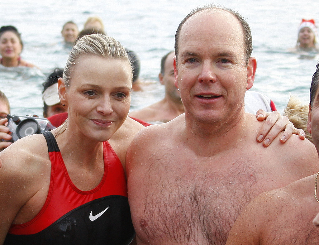 Prince Albert and his swimmer girlfriend, Charlene Wittstock, take part in the traditional Christmas swim in Monaco in 2009.