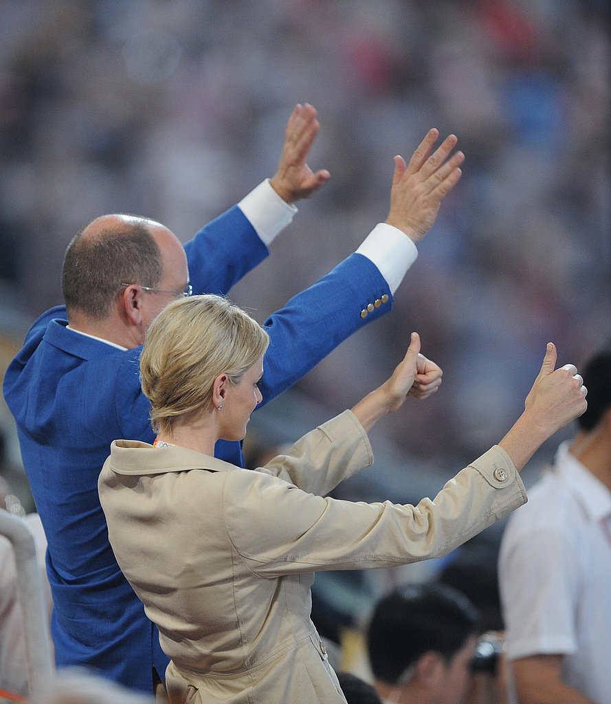 Monaco's Prince Albert II and girlfriend Charlene Wittstock attend the opening ceremony of the 2008 Beijing Olympic Games.