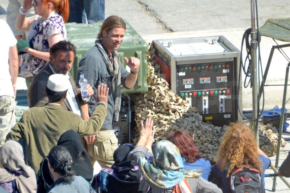Brad Pitt waved to a lucky crew member.