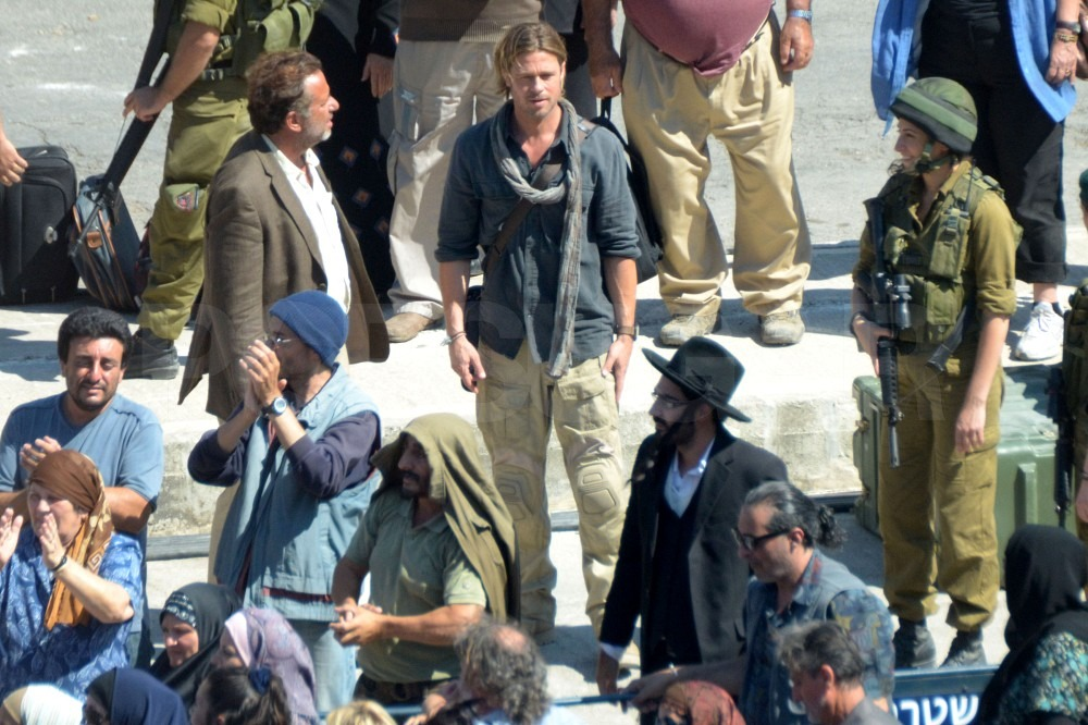 Brad Pitt wears a scarf on the set of World War Z.