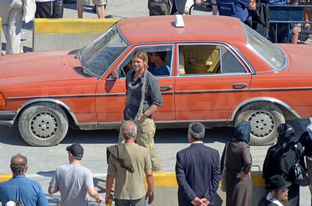 Brad Pitt shoots in front of a car in Malta.