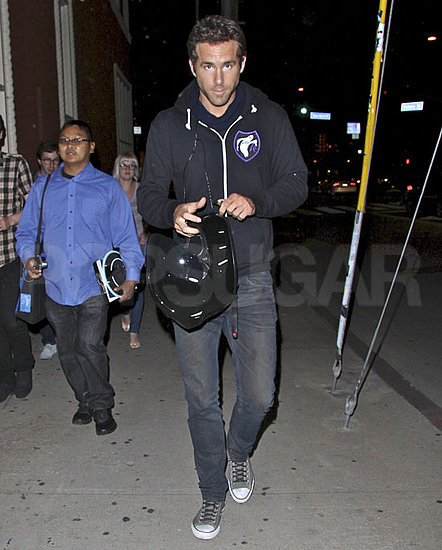 Ryan Reynolds carrying his motorcyle helmet in LA.