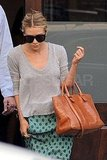 Ashley Olsen carried a purse from her collection The Row.