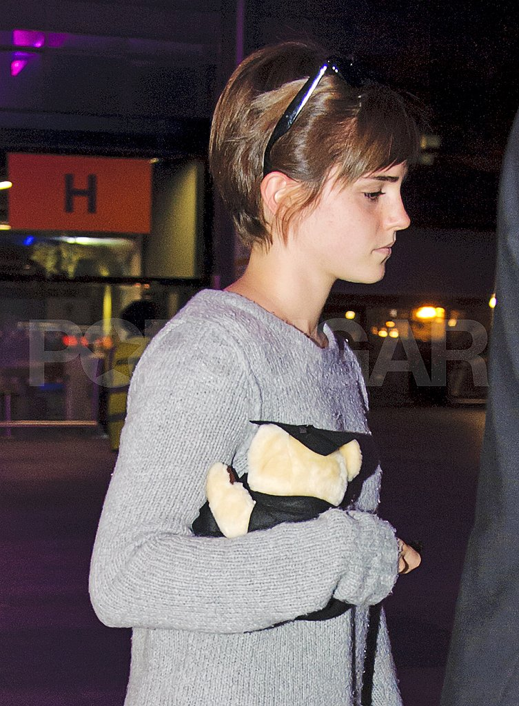 Emma Watson Makes a Beary Cute Landing in London