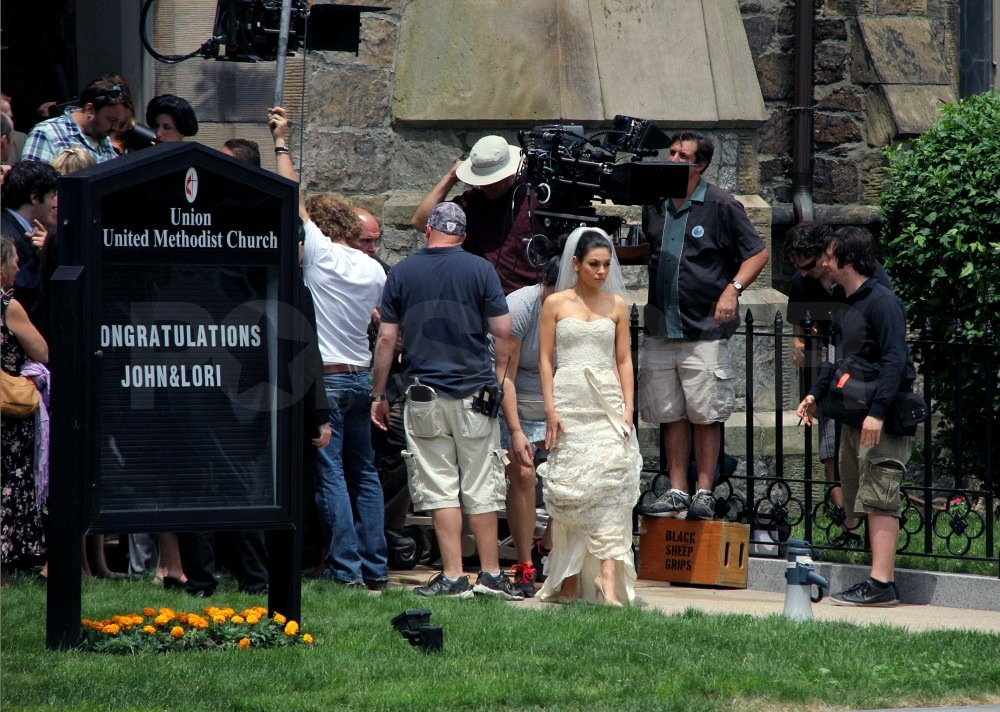 Mila Kunis took a break while the crew set up the shot.
