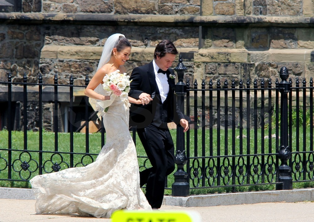 Mila Kunis and Mark Wahlberg held hands.