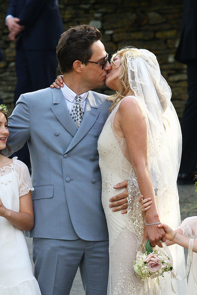 Kate Moss and Jamie Hince locked lips after tying the knot in Southrop, England, in July 2011.