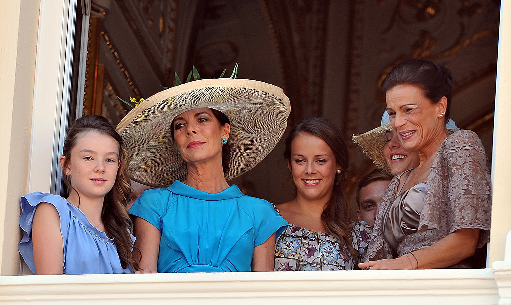Princess Alexandra of Hanover, Princess Caroline of Hanover, Pauline Ducruet, and Princess Stephanie of Monaco look out from the balcony.
