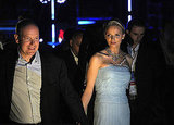 Princess Charlene of Monaco and Prince Albert II of Monaco walk hand in hand at the Jean Michel Jarre concert.
