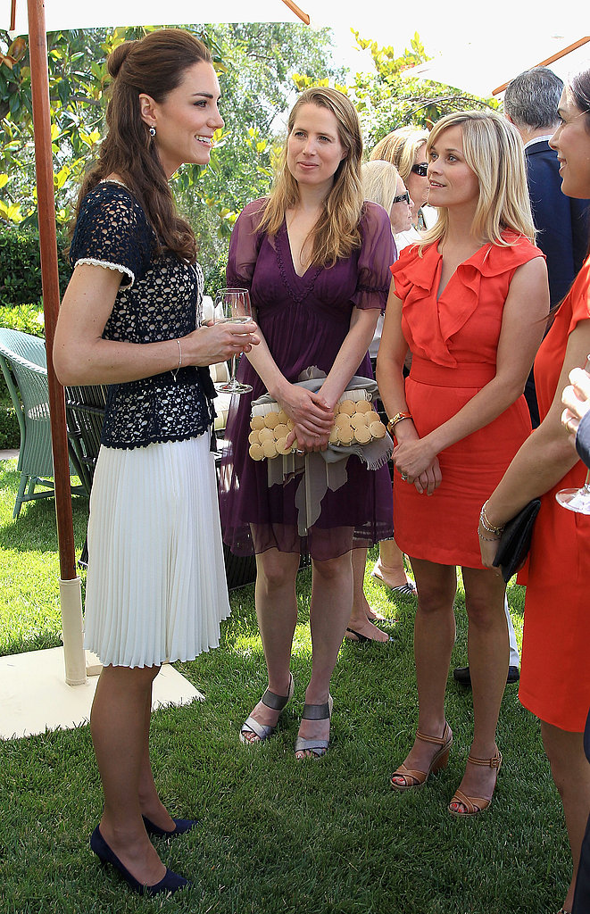 Kate Middleton and Reese Witherspoon talk at the Tusk Trust reception in Beverly Hills.