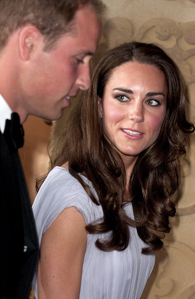 Kate looks back at her husband Prince William at the BAFTA event.