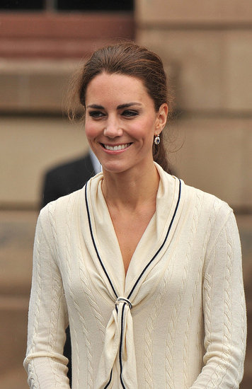 July 4th, 2011  Visiting the Province House in Charlottetown, Prince Edward Island.   Kate wears an Alexander McQueen by Sarah Burton knit sailor dress. She paired the look with sapphire earrings.