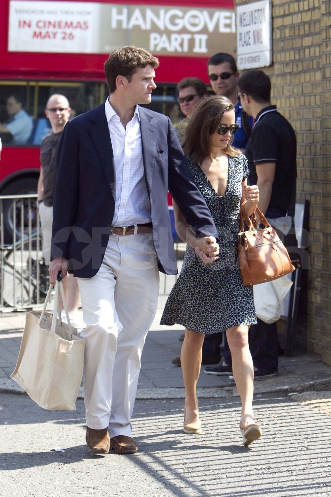 Pippa Middleton and Alex Loudon hold hands on their way to watch cricket.
