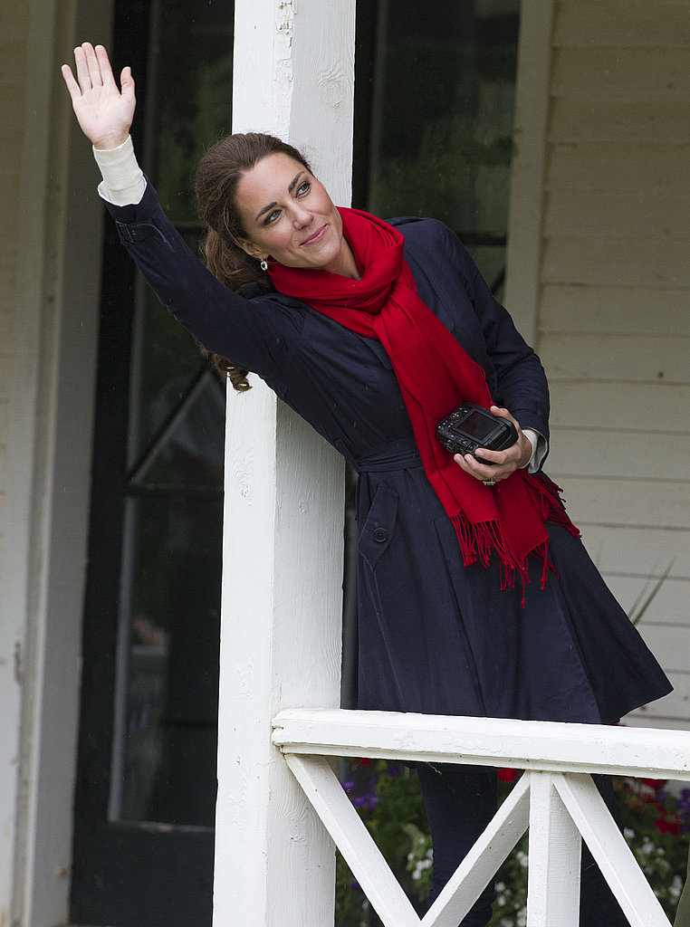 July 4th, 2011 In Charlottetown in Prince Edward Island, Canada.   Kate wears a navy Ted Baker trench and a red Hugo Boss scarf.