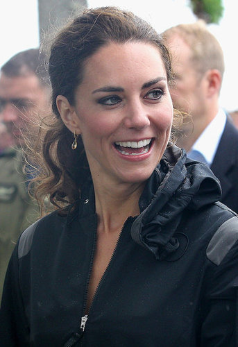 Kate Middleton smiled through the rain drops.