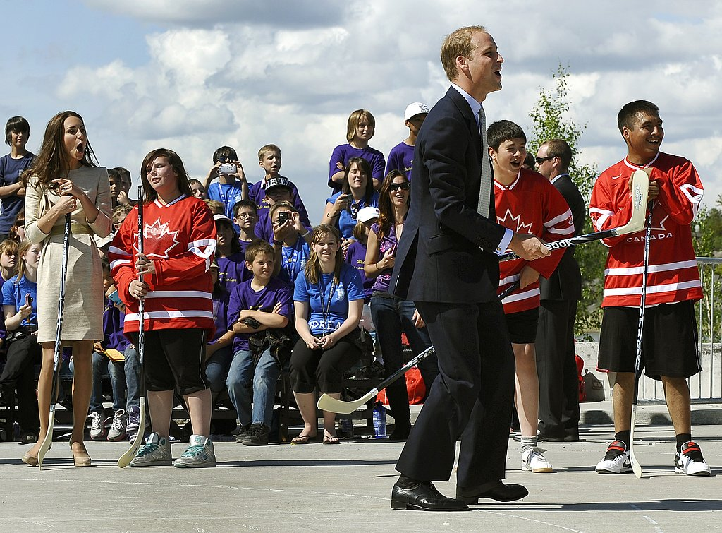 Kate Middleton and Prince William play hockey in Yellowknife, Northwest Territories, Canada.