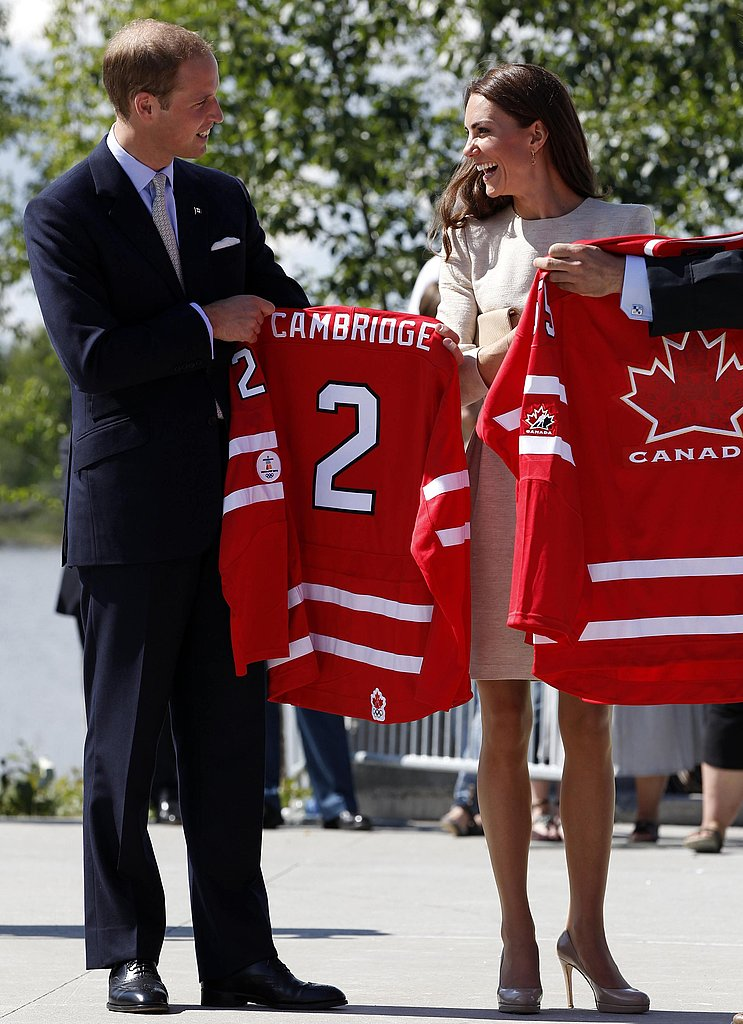 Kate Middleton and Prince William hold up hockey jerseys in Canada.