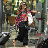 Eva Longoria ran through the airport with her luggage.