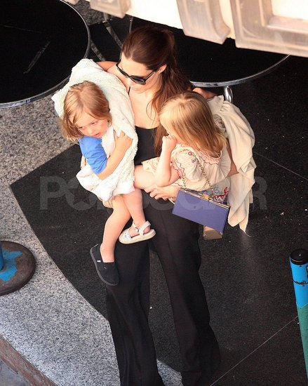 Angelina Jolie carries Knox and Vivienne in Malta.