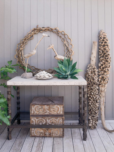 Veranda magazine featured this perfectly charming tabletop that uses one large succulent to make a big statement. Try going big with one succulent statement piece on a table at your home.