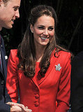 July 8th, 2011 Visiting the ENMAX Conservatory at the Calgary Zoo.    Kate wears a full-skirted red Marianne suit from Catherine Walker. The Queen's diamond maple leaf pin adorns her left side.
