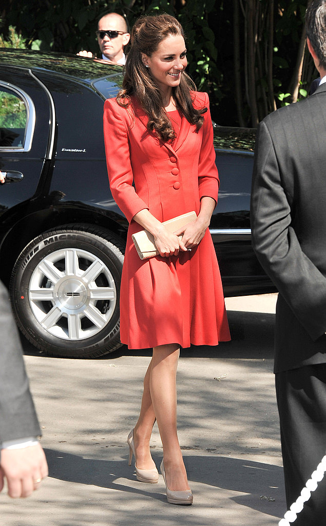 Kate Middleton paired nude pumps with her bright coat.