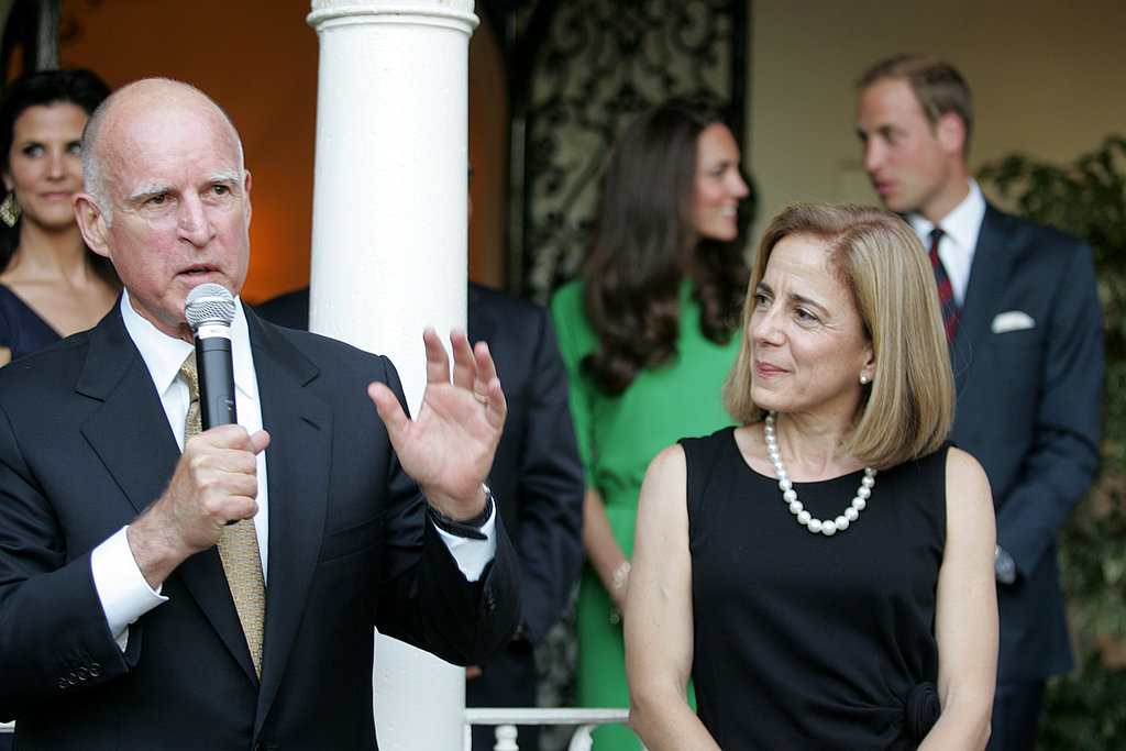 Kate Middleton and Prince William enjoy a moment together as Governor Jerry Brown gives a speech at the cocktail reception.