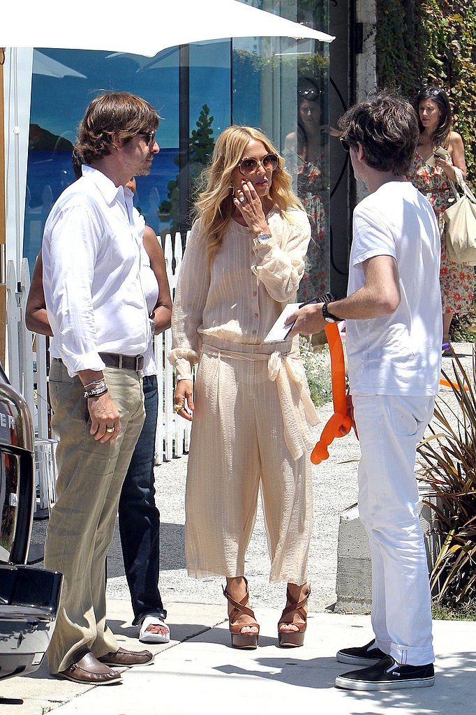Rachel Zoe and Rodger Berman chatted with a friend.