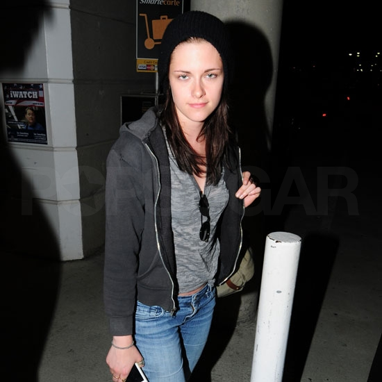 Kristen Stewart smiling after meeting up with Robert Pattinson in Toronto.