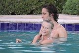 Julianne Hough swims in the pool with Diego Boneta.