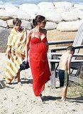 Victoria Beckham on the beach pregnant.