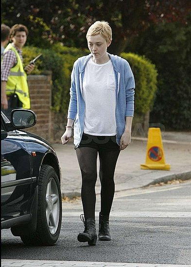 Dakota Fanning sported a short hairstyle on set.