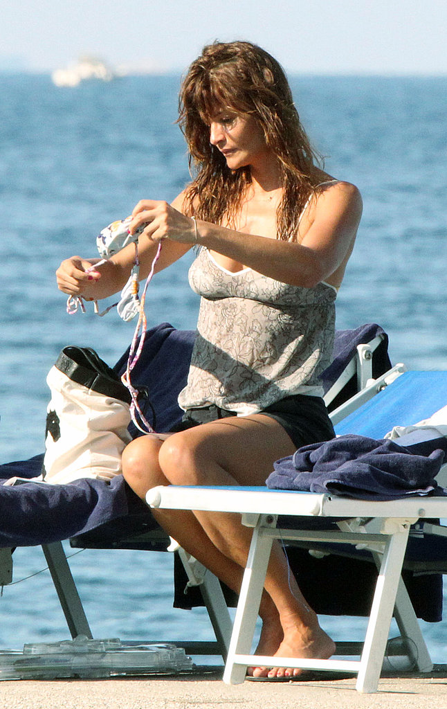 Helena Christensen leaves the beach.