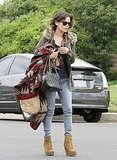 Rachel Bilson carried her bag and a printed sweater.