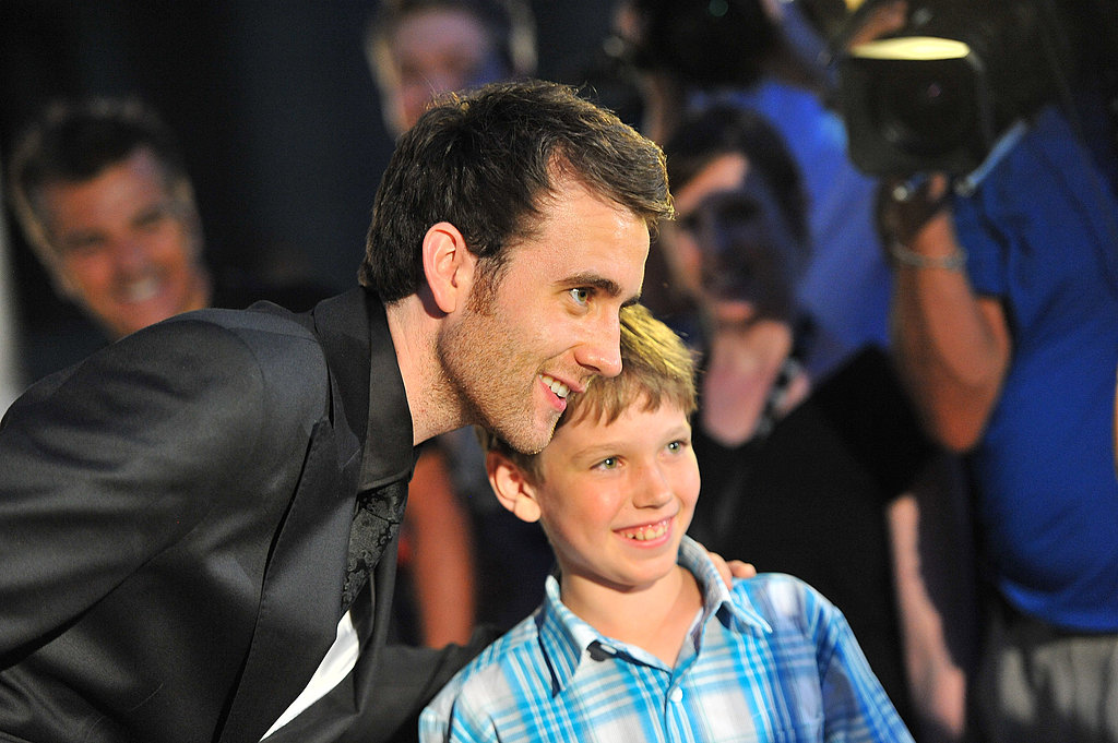 Matthew Lewis takes a pic with a little boy at the Canadian premiere of Harry Potter and the Deathly Hallows Part 2.