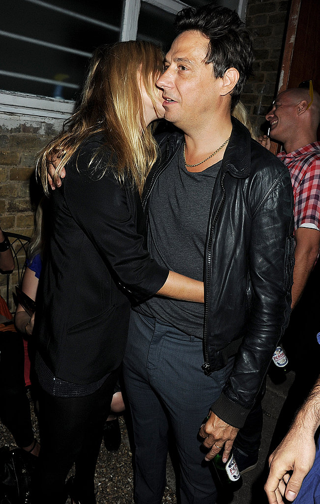 Kate Moss and Jamie Hince hug.