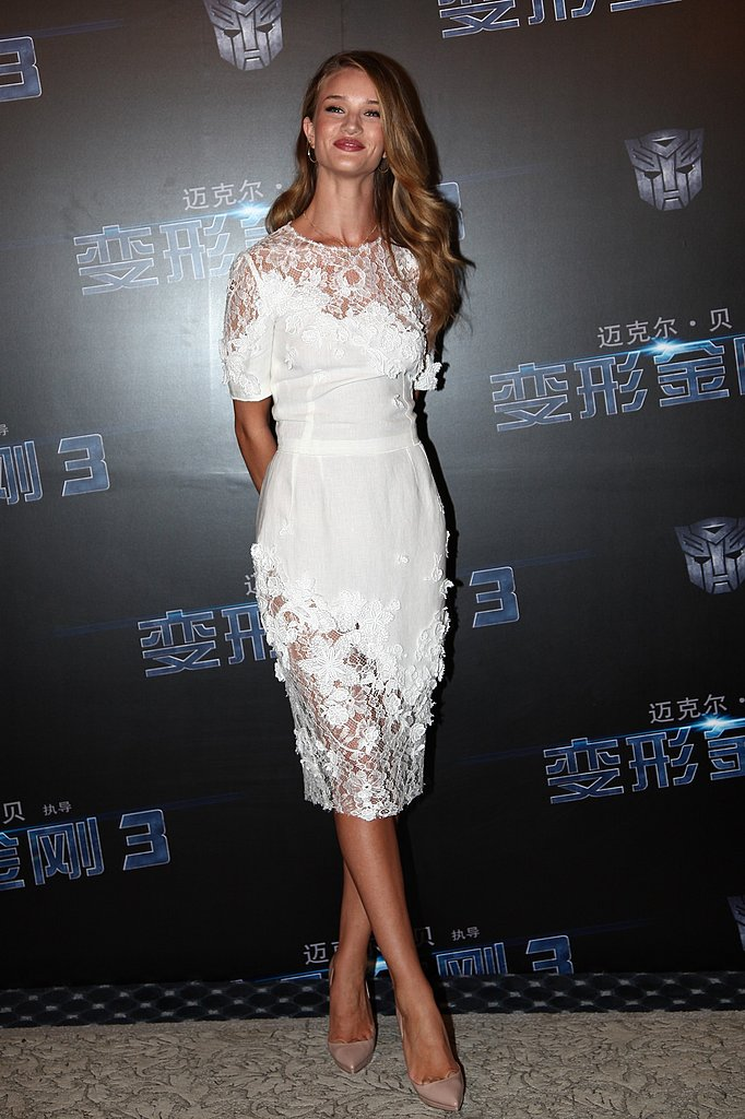 Rosie Huntington-Whiteley wears white Dolce & Gabbana in China.