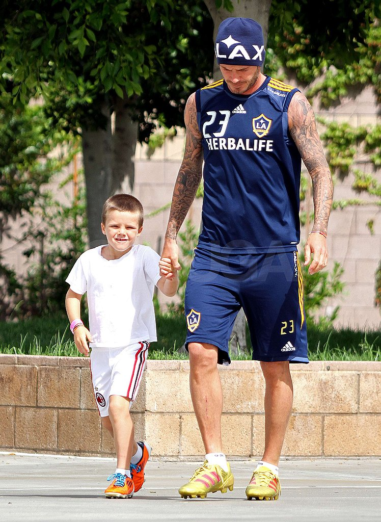Cruz Beckham flashed a cute smile with dad David Beckham.