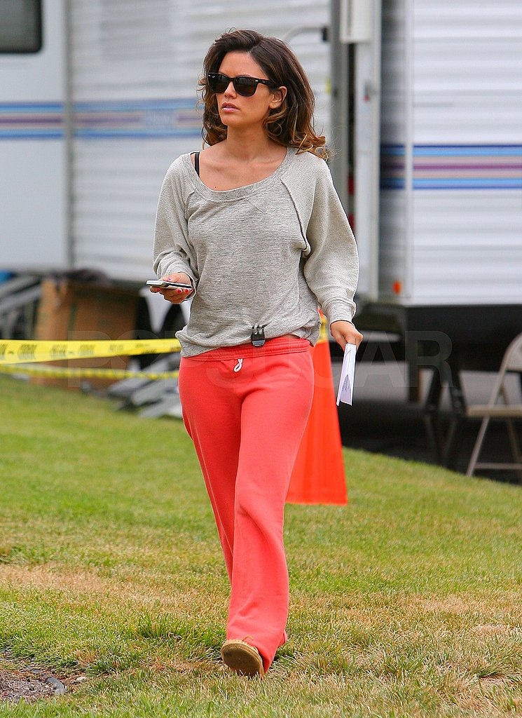 Rachel Bilson carried her phone to the wardrobe trailer.