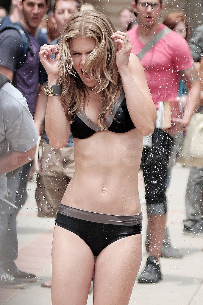 AnnaLynne McCord gets wet in a bikini.
