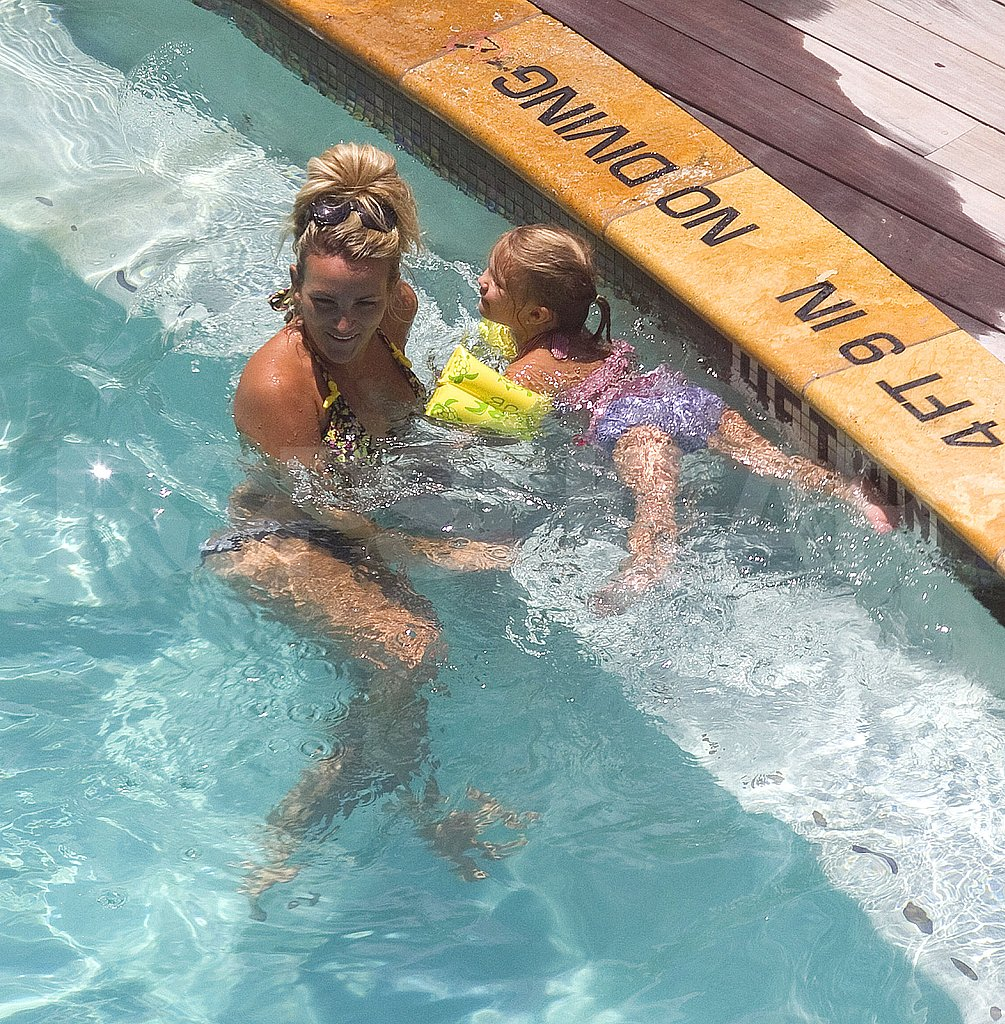 Bikini-clad Jamie Lynn Spears teaches daughter Maddie to swim.
