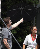 Javier Bardem holds an umbrella.
