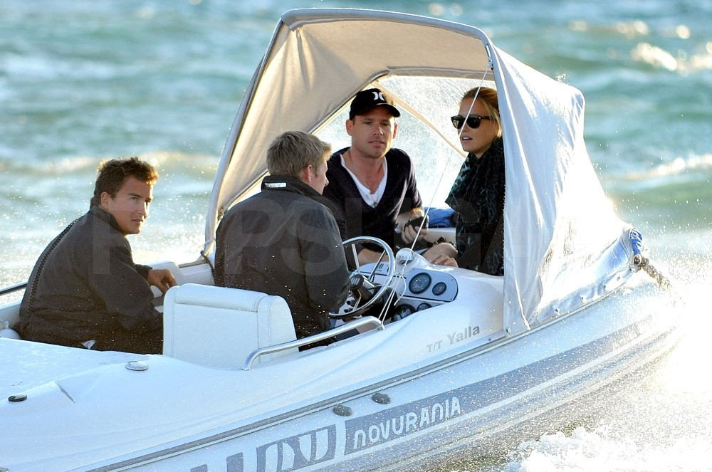 Bar Refaeli and David Fisher boarded a small boat.