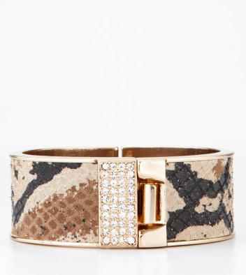 A python print and sparkly accompaniments make for a luxe statement piece.  Ann Taylor Snake Print Cuff ($58)