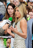 Jennifer Aniston talks to reporters.